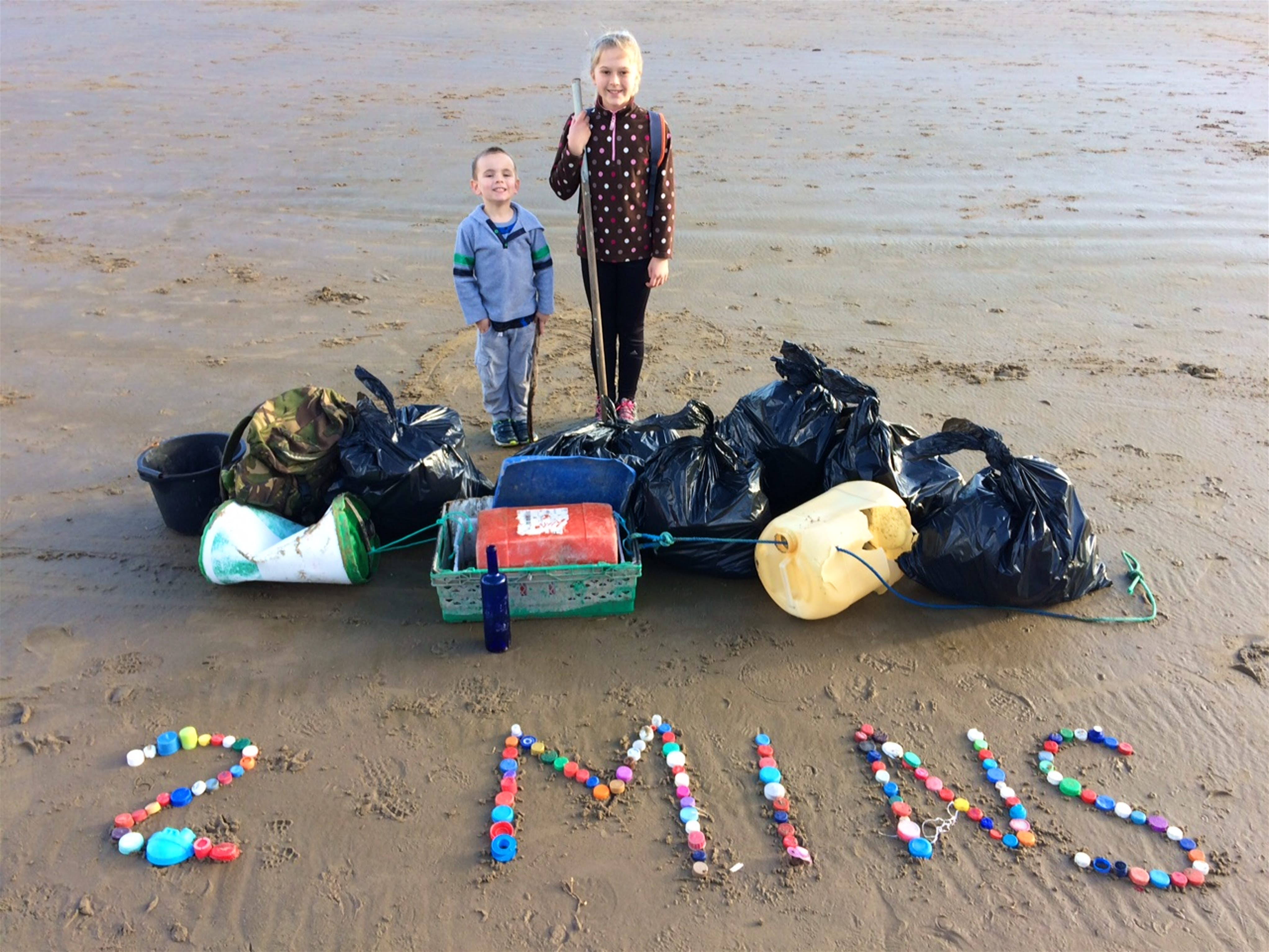 Isaac Rees and Emi Chubb with rubbish collected in a two minute spell. image courtesy of Julie OShea